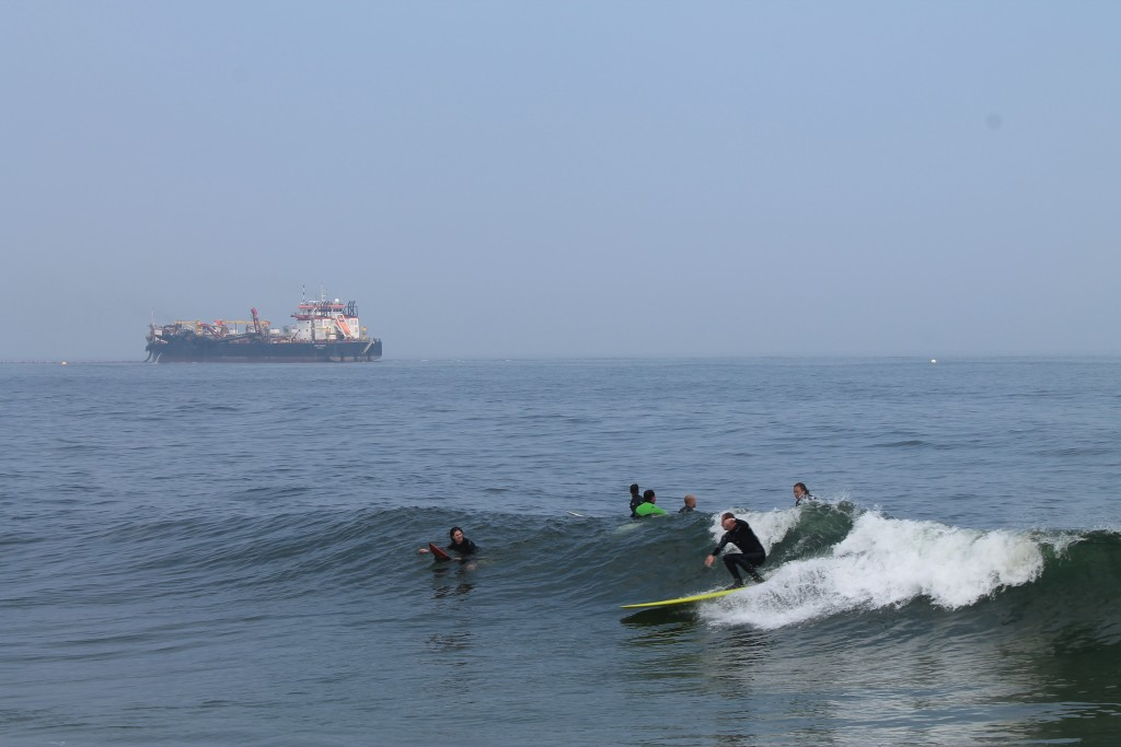 Surfing in OCNJ. Photo by Josh Kinney